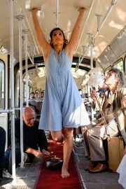 Watch this woman swim, morph, and fly inside a bus